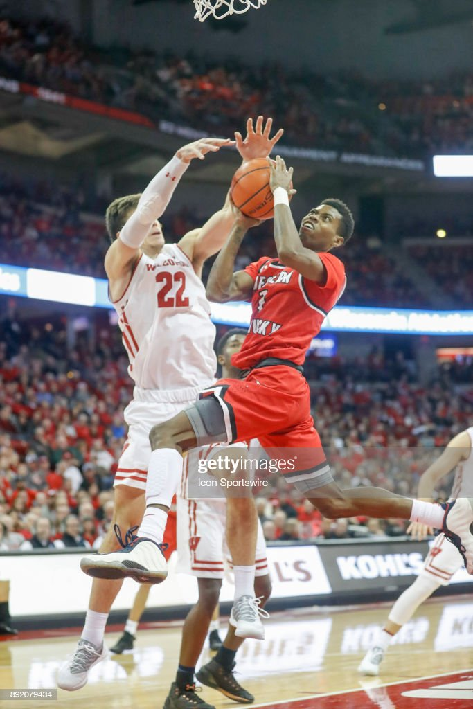 Wisconsin forward Ethan Happ (22) fouls Western Kentucky guard Lamonte Bearden (1) during a college basketball game between the University of Wisconsin Badgers and the Western Kentucky University Hilltoppers on December 13, 2017 at the Kohl Center in Madison, WI.
