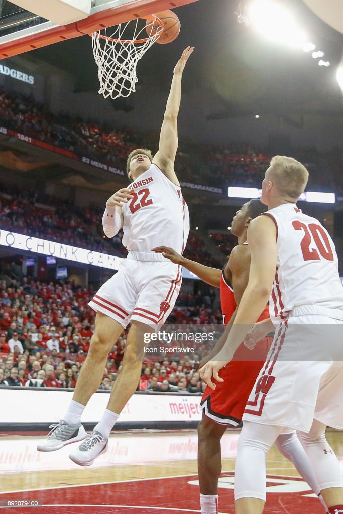 Wisconsin forward Ethan Happ (22) scores on a lay up during a college basketball game between the University of Wisconsin Badgers and the Western Kentucky University Hilltoppers on December 13, 2017 at the Kohl Center in Madison, WI.