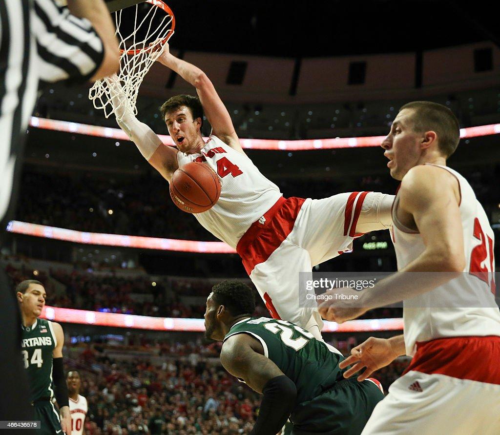 Wisconsin forward Frank Kaminsky dunks over Michigan State guard/forward Branden Dawson during the second half of the Big Ten Men's Tournament...