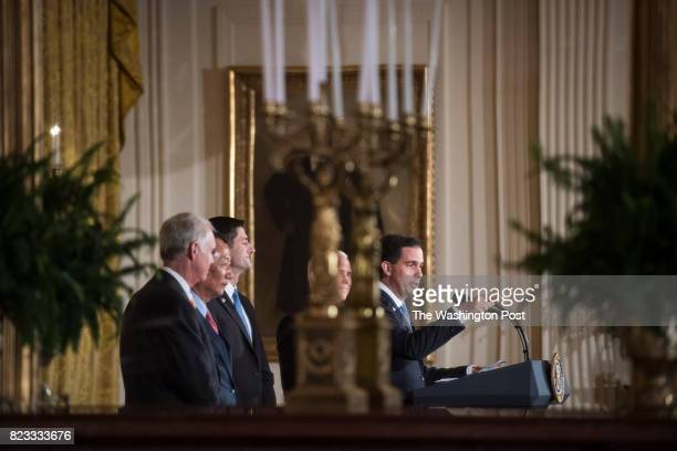 Wisconsin Gov Scott Walker accompanied by Vice President Mike Pence and House Speaker Paul Ryan of Wis speaks before President Donald Trump announces...