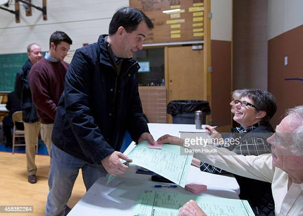 Wisconsin Gov Scott Walker arrives to casts his ballot on election day at Jefferson Elementary School November 2014 in Milwaukee Walker is running in...