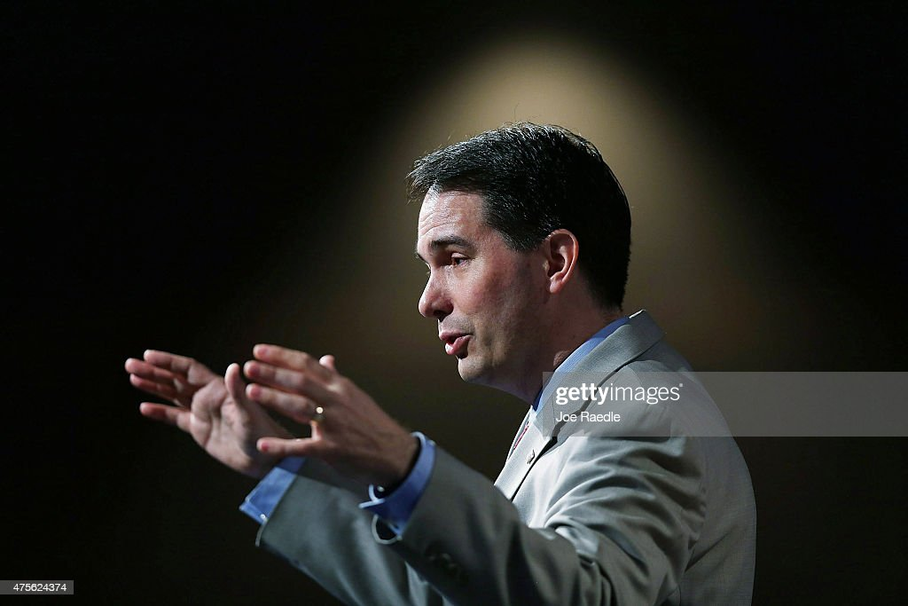 Wisconsin Governor <a gi-track='captionPersonalityLinkClicked' href=/galleries/search?phrase=Scott+Walker+-+Politiek&family=editorial&specificpeople=7511934 ng-click='$event.stopPropagation()'>Scott Walker</a> and possible Republican presidential candidate speaks during the Rick Scott's Economic Growth Summit held at the Disney's Yacht and Beach Club Convention Center on June 2, 2015 in Orlando, Florida. Many of the leading Republican presidential candidates are scheduled to speak during the event.