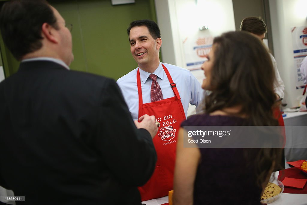 Wisconsin Governor <a gi-track='captionPersonalityLinkClicked' href=/galleries/search?phrase=Scott+Walker+-+Politician&family=editorial&specificpeople=7511934 ng-click='$event.stopPropagation()'>Scott Walker</a> greets guests at the Republican Party of Iowa's Lincoln Dinner at the Iowa Events Center on May 16, 2015 in Des Moines, Iowa. The event sponsored by the Republican Party of Iowa gave several Republican presidential hopefuls an opportunity to strengthen their support among Iowa Republicans ahead of the 2016 Iowa caucus.
