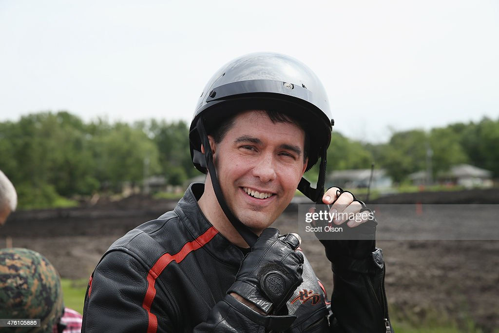 Wisconsin Governor <a gi-track='captionPersonalityLinkClicked' href=/galleries/search?phrase=Scott+Walker+-+Politician&family=editorial&specificpeople=7511934 ng-click='$event.stopPropagation()'>Scott Walker</a> prepares to ride in a Roast and Ride event hosted by freshman Senator Joni Ernst (R-IA) on June 6, 2015 near Boone, Iowa. Ernst is hoping the event, which featured a motorcycle tour, a pig roast, and speeches from several 2016 presidential hopefuls, becomes an Iowa Republican tradition.