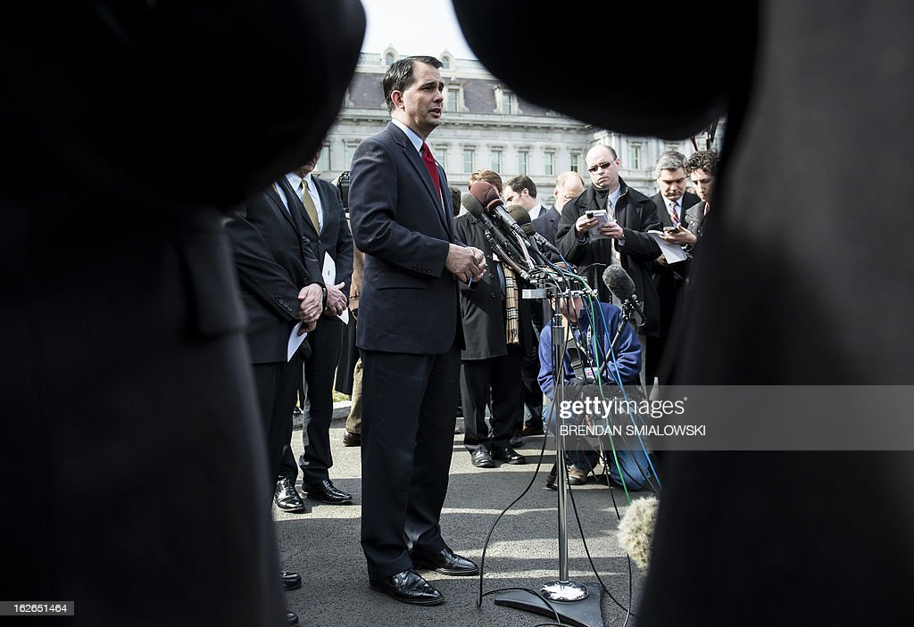 Wisconsin Governor Scott Walker speaking to reporters outside the White House after a luncheon February 25, 2013 in Washington, DC. US President Barack Obama and US Vice President Joseph R. Biden hosted governors from around the United States for a luncheon while the state leaders where in Washington for the National Governors Association's annual winter meeting. AFP PHOTO/Brendan SMIALOWSKI
