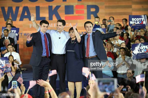 Wisconsin Governor Scott Walker stands on stage with his wife Tonette and sons Alex and Matt afer announcing that he will seek the Republican...