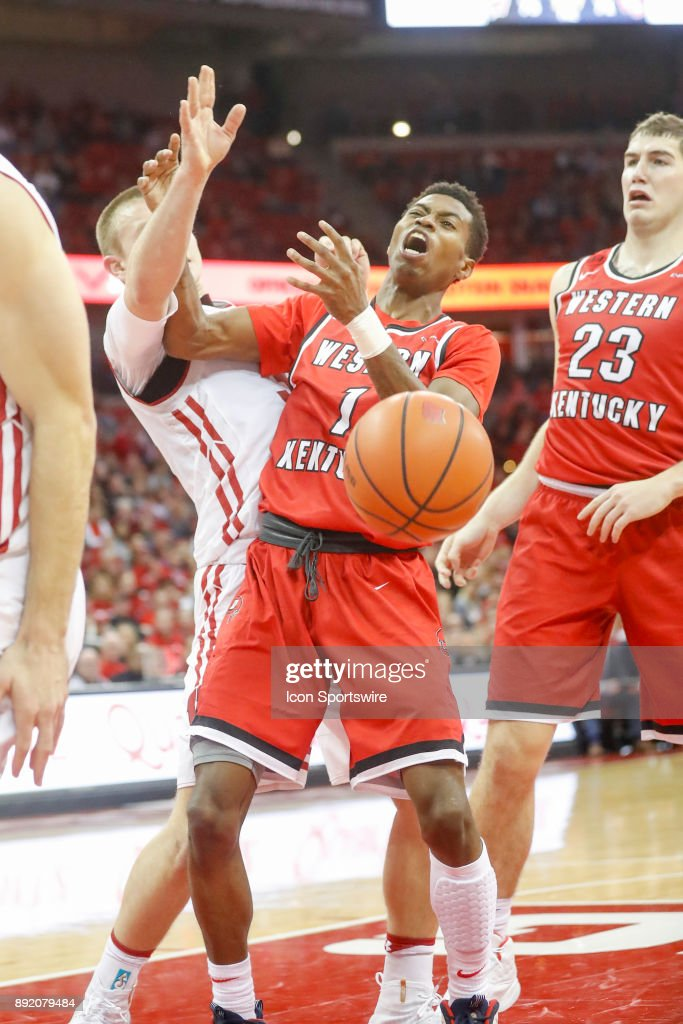 Wisconsin guard Brad Davison (34) is fouled by Western Kentucky guard Lamonte Bearden (1) during a college basketball game between the University of Wisconsin Badgers and the Western Kentucky University Hilltoppers on December 13, 2017 at the Kohl Center in Madison, WI.