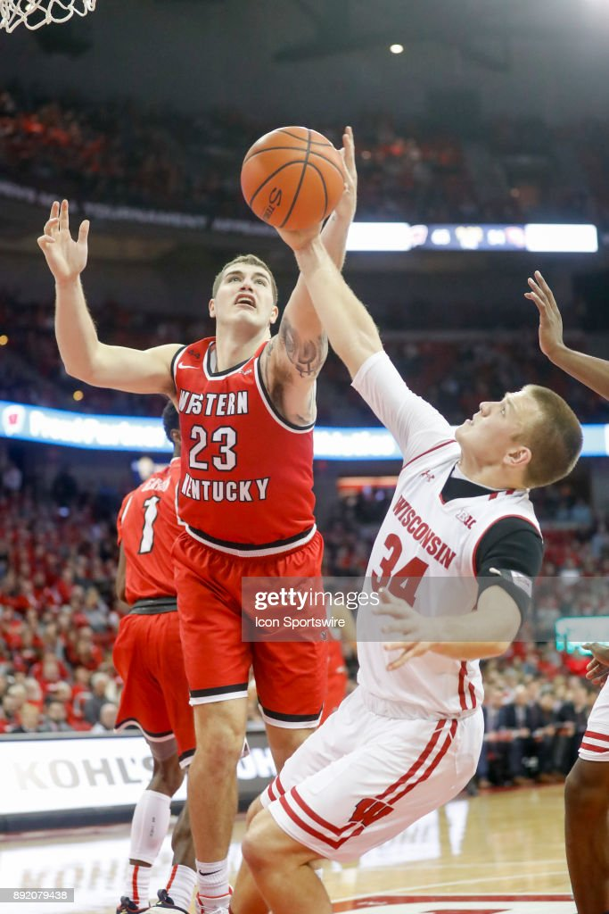 Wisconsin guard Brad Davison (34) keeps Western Kentucky forward Justin Johnson (23) from scoring during a college basketball game between the University of Wisconsin Badgers and the Western Kentucky University Hilltoppers on December 13, 2017 at the Kohl Center in Madison, WI.