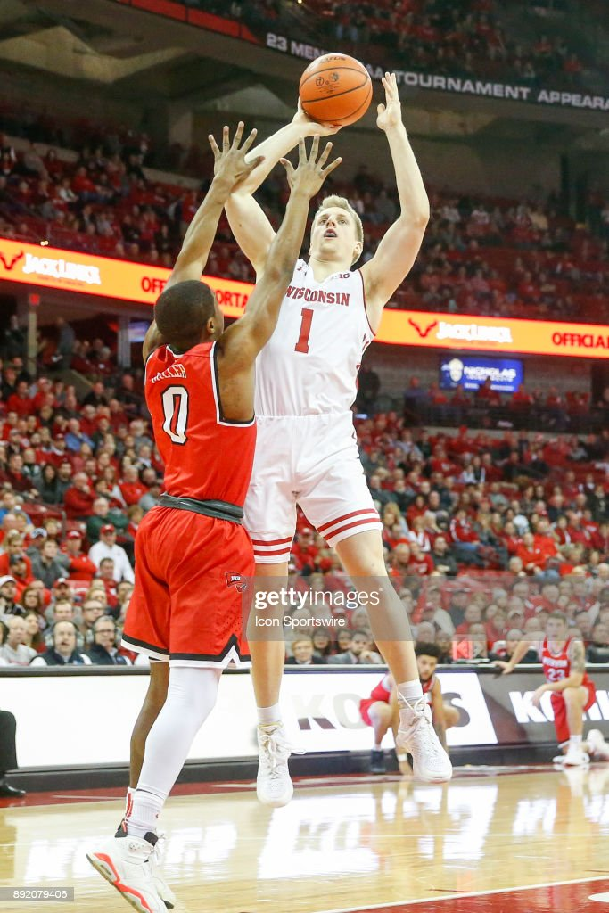 Wisconsin guard Brevin Pritzl(1) shoots over Western Kentucky guard Tyler Miller (0) during a college basketball game between the University of Wisconsin Badgers and the Western Kentucky University Hilltoppers on December 13, 2017 at the Kohl Center in Madison, WI.