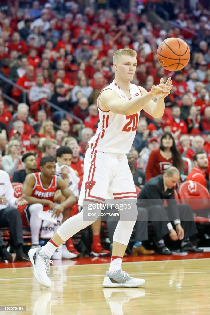 Wisconsin guard T.J. Schlundt (20) passes the ball during a college basketball game between the University of Wisconsin Badgers and the Western Kentucky University Hilltoppers on December 13, 2017 at the Kohl Center in Madison, WI.