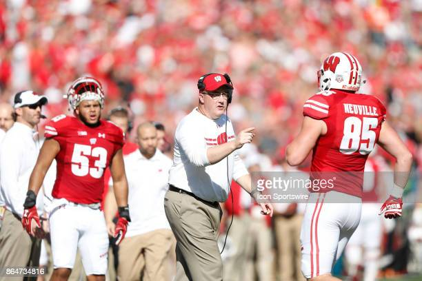 Wisconsin head coach Paul Chryst congratulates Wisconsin Badger tight end Zander Neuville during a Big Ten football game between the University of...