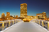 USA, Wisconsin, Milwaukee, Pedestrian bridge with skyline in background