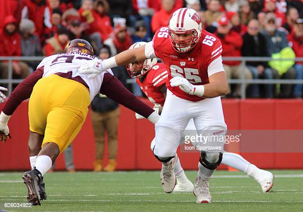 Wisconsin offensive lineman Ryan Ramczyk blocks and moves up field during game action Wisconsin beat Minnesota by a final score of 3117 at Camp...