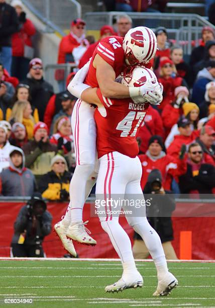 Wisconsin outside linebacker Vince Biegel and TJ Watt celebrate after a defensive stop during game action Wisconsin beat Minnesota by a final score...