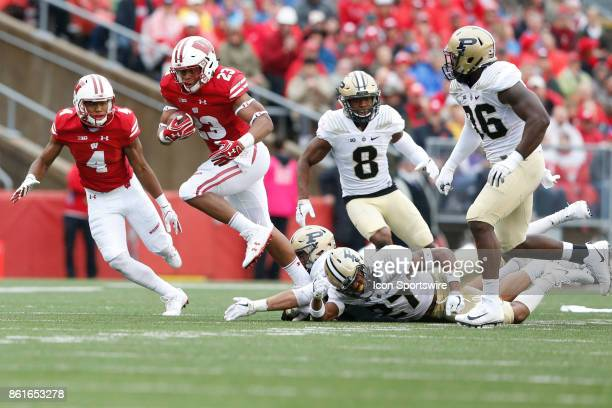 Wisconsin running back Jonathan Taylor breaks a tackle during a Big Ten football game between the University of Wisconsin Badgers and the Purdue...