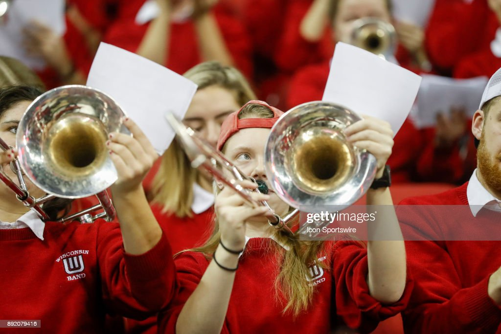 Wisconsin trombone player tries to read her music while playing during a college basketball game between the University of Wisconsin Badgers and the Western Kentucky University Hilltoppers on December 13, 2017 at the Kohl Center in Madison, WI.