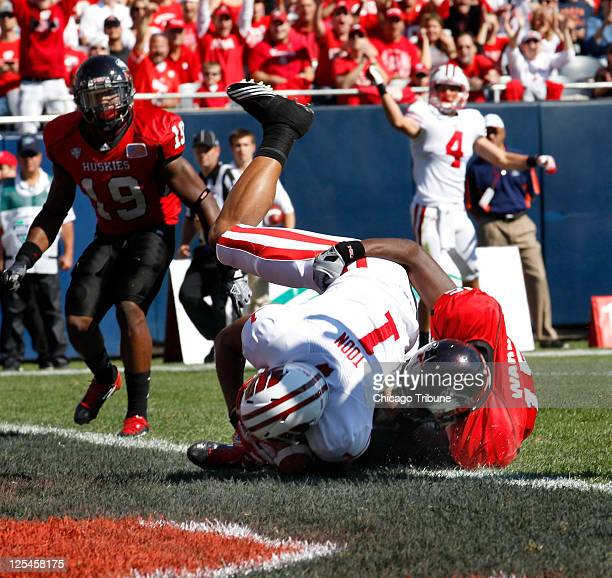 Wisconsin wide receiver Jared Abbrederis pumps his fist as teammate wide receiver Nick Toon scores a touchdown on top of Northern Illinois defensive...