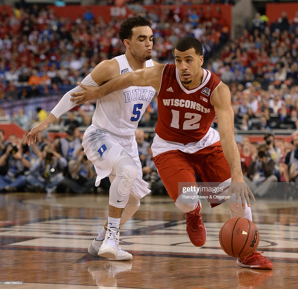 Wisconsin's Traevon Jackson drives by Duke's Tyus Jones during the first half of the NCAA National Championship game on Monday April 6 at Lucas Oil...