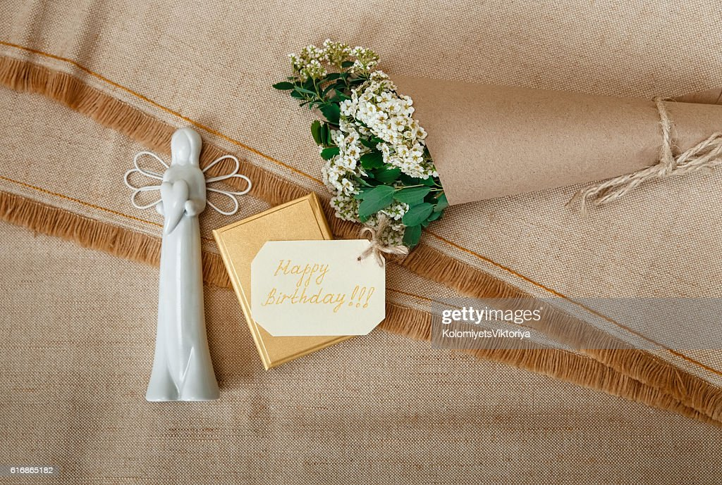 Wish Card,Present Box,Ceramic Angel.Bouquet Flowers.Rough Tablecloth : Stock Photo