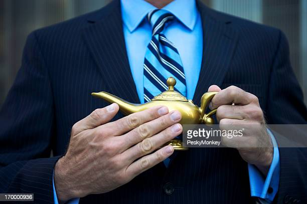 Wishing Businessman Rubbing Golden Magic Lamp with Three Wishes