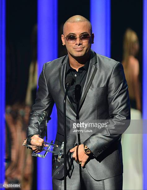Wisin accepts award at the 2015 Billboard Latin Music Awards presented by State Farm on Telemundo at Bank United Center on April 30 2015 in Miami...