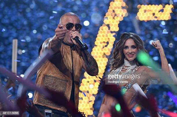 Wisin and Anahi perform onstage at Univision's Premios Juventud 2015 at Bank United Center on July 16 2015 in Miami Florida