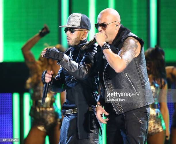 Wisin and Yandel perform onstage during the 14th Annual Latin GRAMMY Awards held at Mandalay Bay Resort and Casino on November 21 2013 in Las Vegas...