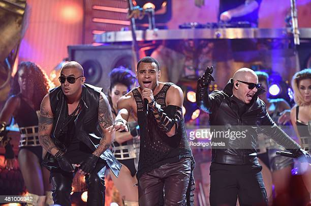 Wisin Mohombi and Pitbull perform onstage at Univision's Premios Juventud 2015 at Bank United Center on July 16 2015 in Miami Florida