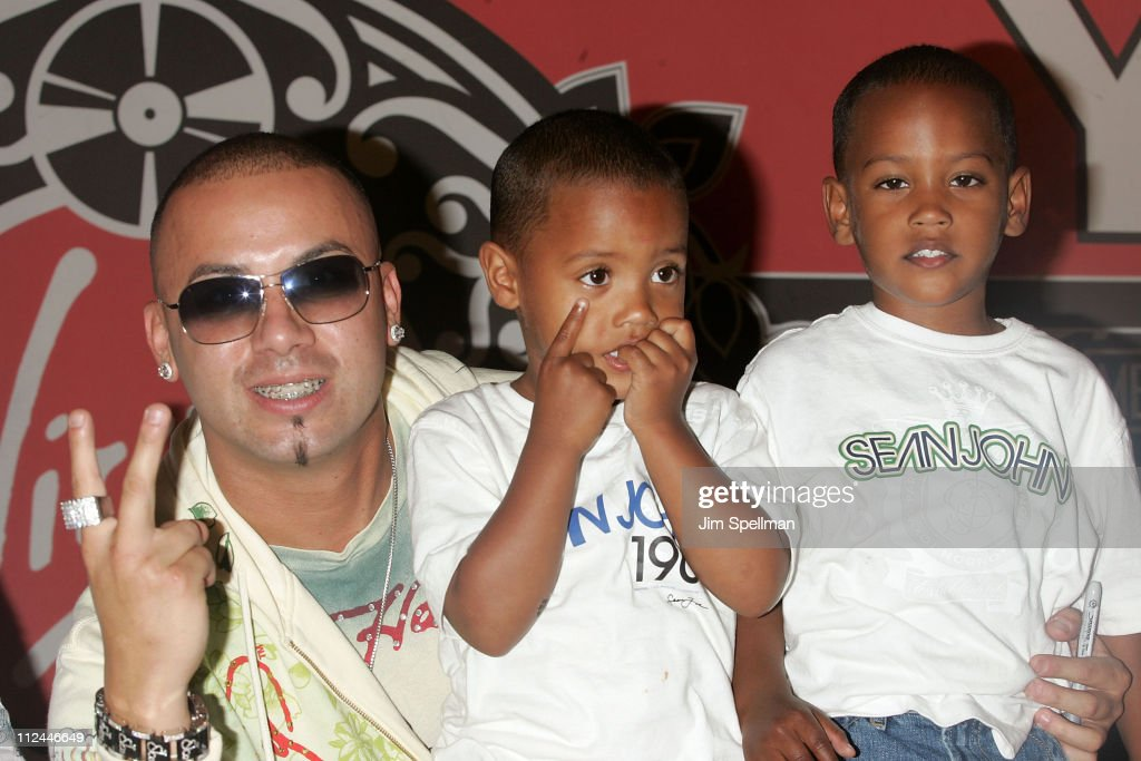 Wisin of Wisin and Yandel poses with young fans at a CD Signing for Wisin and Yandel 'Los Extraterrestres Otra Dimension' on June 5 2008 at Virgin...