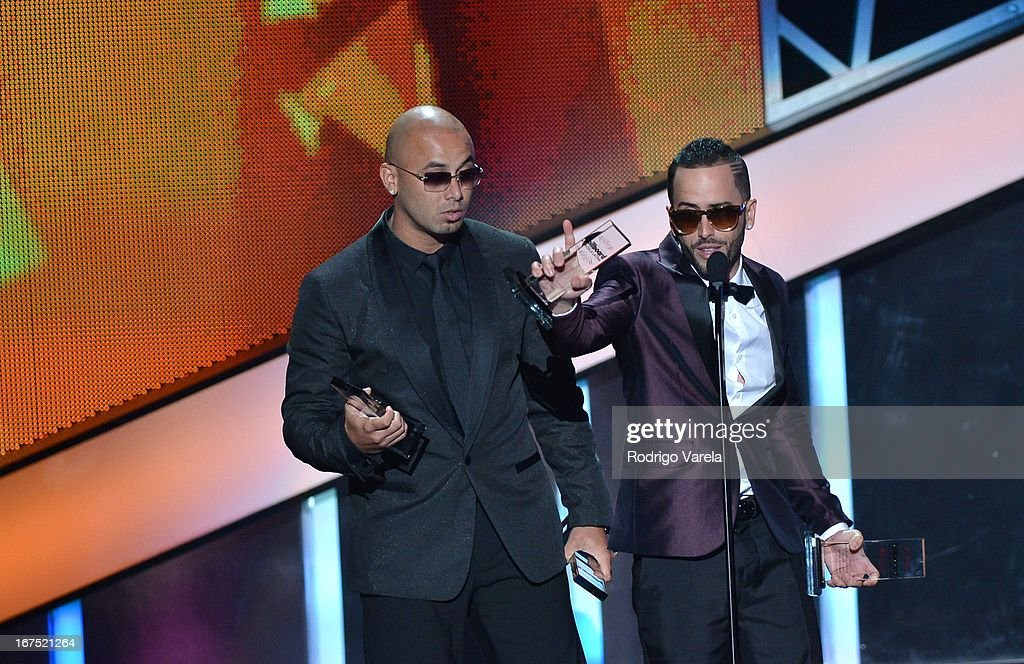 Wisin y Yandel on stage at Billboard Latin Music Awards 2013 at Bank United Center on April 25, 2013 in Miami, Florida.