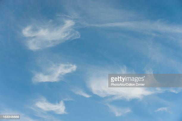 Wispy clouds in sky