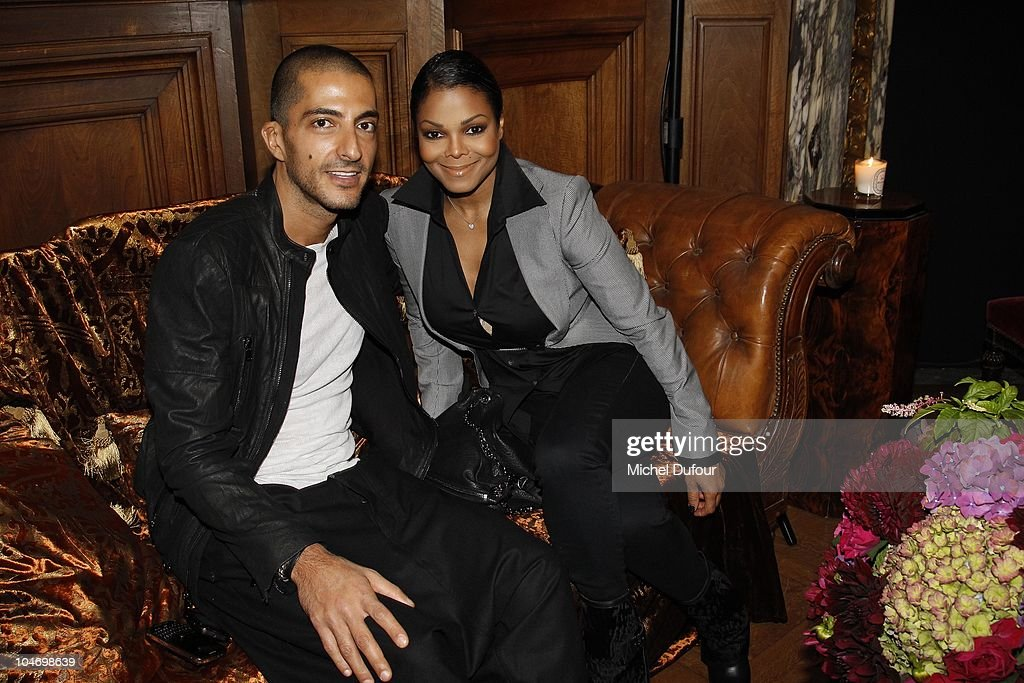 Wissam Al Mana and Janet Jackson attend the John Galliano Ready to Wear Spring/Summer 2011 show during Paris Fashion Week at Opera Comique on October 3, 2010 in Paris, France.