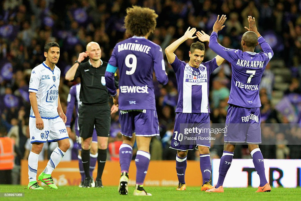 <<a gi-track='captionPersonalityLinkClicked' href=/galleries/search?phrase=Wissam+Ben+Yedder&family=editorial&specificpeople=7426311 ng-click='$event.stopPropagation()'>Wissam Ben Yedder</a> from Toulouse celebrates his victory with team mate Jean Daniel Akpa Akpro at the end of the match between Toulouse v Troyes> at Stadium Municipal on May 7, 2016 in Toulouse, France.