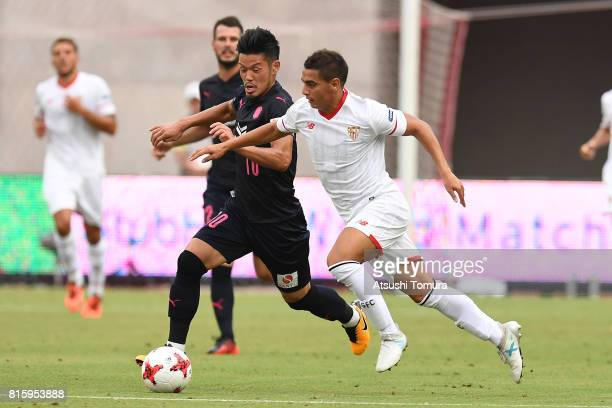 Wissam Ben Yedder of Sevilla FC and Hotaru Yamaguchi of Cerezo Osaka compete for the ball during the preseason friendly match between Cerezo Osaka...