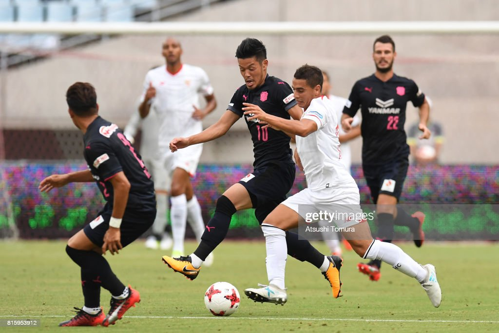 Wissam Ben Yedder of Sevilla FC (R) and Hotaru Yamaguchi of Cerezo Osaka (L) compete for the ball during the preseason friendly match between Cerezo Osaka and Sevilla FC at Yanmar Stadium Nagai on July 17, 2017 in Osaka, Japan.