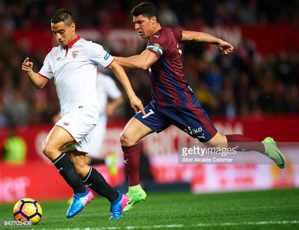 Wissam Ben Yedder of Sevilla FC being followed by Ander Capa of SD Eibar during the La Liga match between Sevilla FC and SD Eibar at Estadio Ramon...