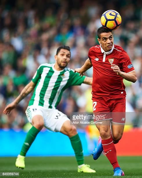 Wissam Ben Yedder of Sevilla FC being followed by Petros Matheus dos Santos of Real Betis Balompie during La Liga match between Real Betis Balompie...