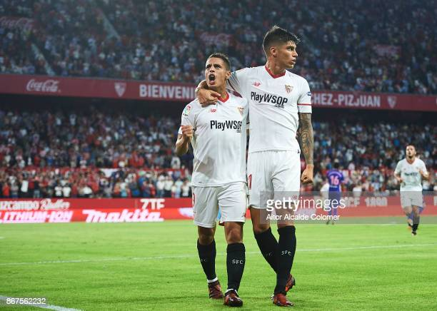 Wissam Ben Yedder of Sevilla FC celebrates after scoring the first goal for Sevilla FC with Joaquin Correa of Sevilla FC during the La Liga match...