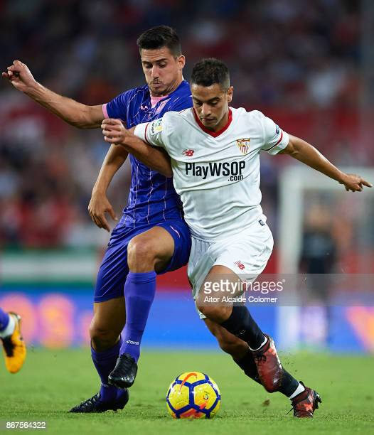 Wissam Ben Yedder of Sevilla FC competes for the ball with Gabriel Appelt of CD Leganes during the La Liga match between Sevilla and Leganes at...