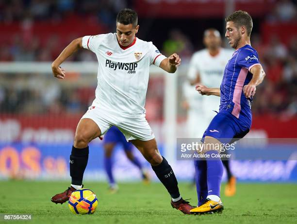 Wissam Ben Yedder of Sevilla FC competes for the ball with Ruben Perez of CD Leganes during the La Liga match between Sevilla and Leganes at Estadio...
