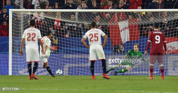 Wissam Ben Yedder of Sevilla FC scores a penalty during the UEFA Champions League group E match between Sevilla FC and Liverpool FC at Estadio Ramon...