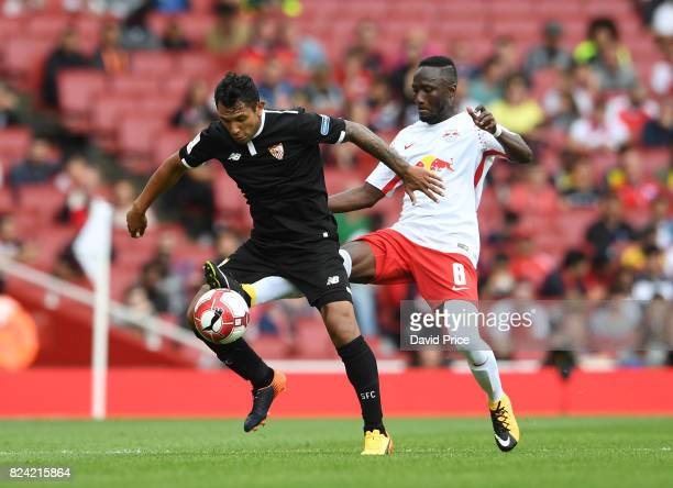 Wissam Ben Yedder of Sevilla is challenged by Naby Keita of RB Leipzig during the match RB Leipzig and Sevilla at Emirates Stadium on July 29 2017 in...