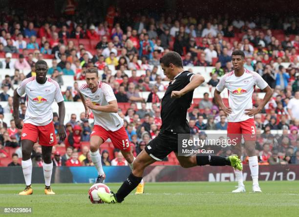 Wissam Ben Yedder of Sevilla scores a goal from a penalty during the Emirates Cup match between RB Leipzig and Sevilla at The Emirates Stadium on...