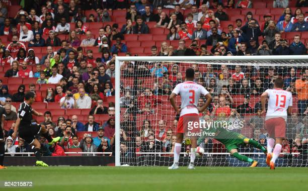 Wissam Ben Yedder scores a goal for Sevilla from the penalty spot during the match RB Leipzig and Sevilla at Emirates Stadium on July 29 2017 in...