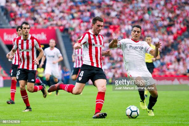 Wissam Ben Yedderi of Sevilla FC competes for the ball with Aymeric Laporte of Athletic Club during the La Liga match between Athletic Club Bilbao...