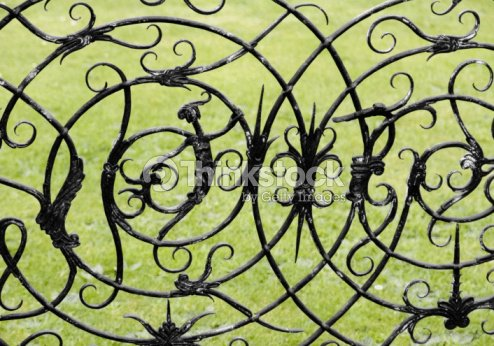 Witch And Witchcraft Symbols On A Wrought Iron Gate Stock Photo