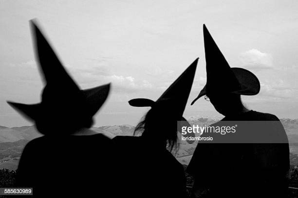 3 witches hats in silhouette