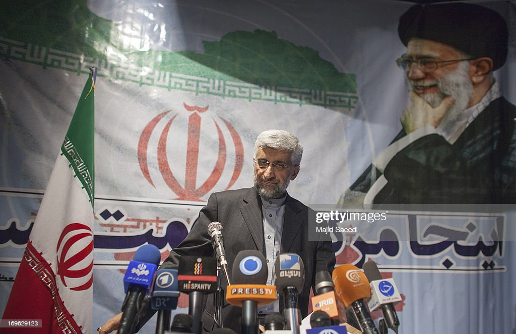With a backdrop of a portrait of the Iranian supreme leader Ayatollah Ali Khamene, Iran's top nuclear negotiator and presidential candidate for the upcoming elections, <a gi-track='captionPersonalityLinkClicked' href=/galleries/search?phrase=Saeed+Jalili&family=editorial&specificpeople=4586103 ng-click='$event.stopPropagation()'>Saeed Jalili</a>, addresses a campaign rally, attended by his female supporters on May 29, 2013 in Tehran, Iran. Jalili, who is running in next month's presidential elections says he will promote a policy of resistance against the West if elected. The elections are scheduled for June 14 and Jalili has stated that he wishes to revive policies of the 1979 Islamic revolution that brought clerics to power.