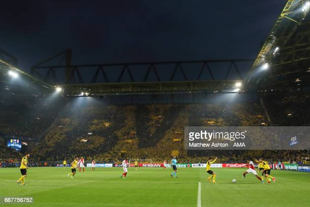 With a backdrop of BVB fans on the Sudtribune at the Westfalenstadion Kylian Mbappe of AS Monaco goes on the attack during the UEFA Champions League...