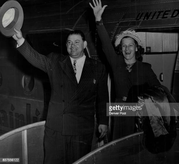 With a big wave and an even bigger smile Mrs Babe Didrikson Zaharias British Women's golf champion greets her Denver friends as she leaves plane from...